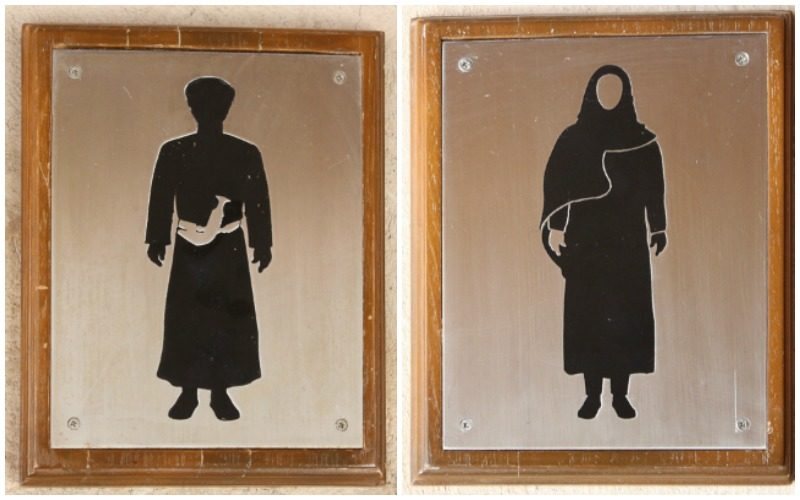 Interesting bathroom signs in Nizwa Oman