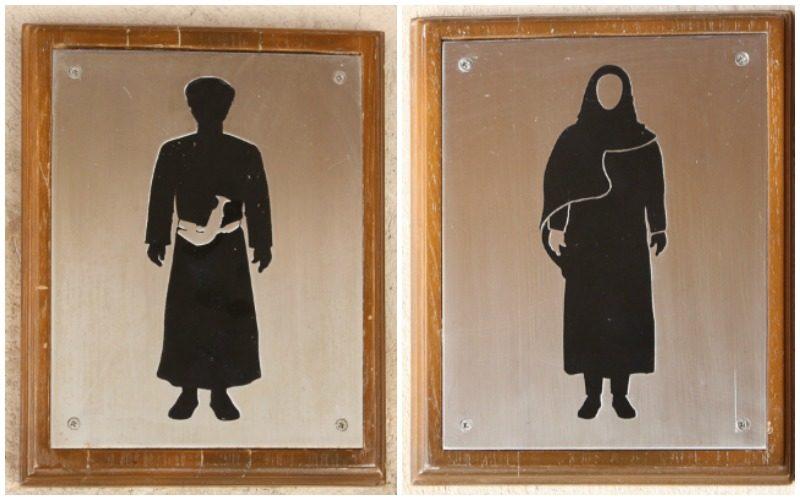 Interesting bathroom signs in Nizwa Oman