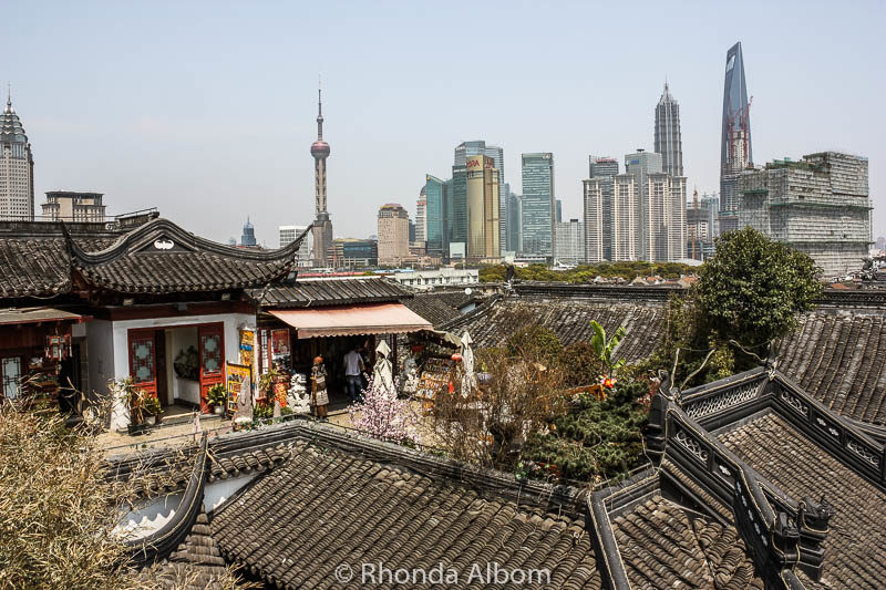 Looking down on Yu Yuan Garden and Bazaar in Shanghai, China it easy to see the juxtaposition of the traditional and modern