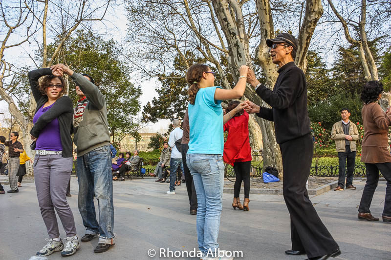 Couples dance in Fuxing Park in Shanghai, China