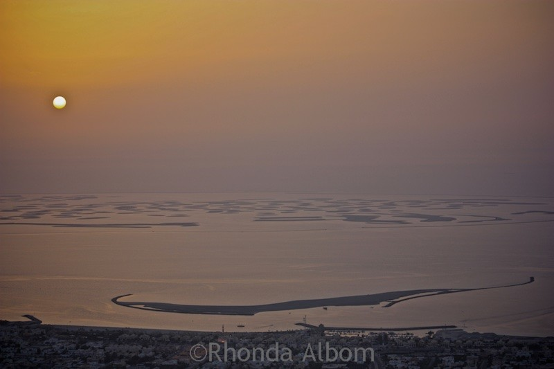 Looking out over the desert at Sunset from the Burj Khalifa the worlds tallest building