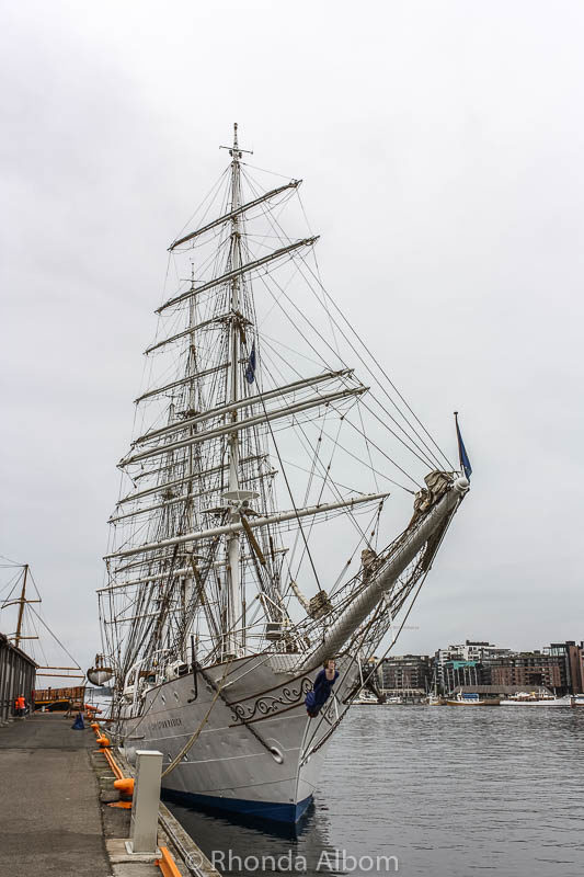A tall ship docked in the harbour in Oslo Norway