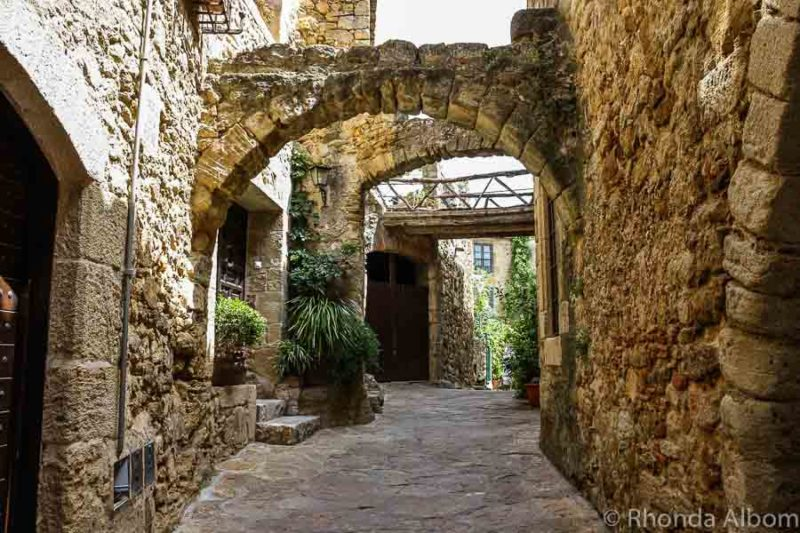 Archways on the narrow cobbled streets in the medieval town of Pals Spain