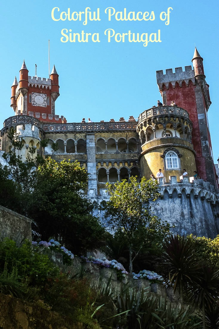 Brightly coloured, fairytale-like Pena Palace is the highlight of Sintra Portugal, a town with cobblestone streets, three palaces, and a castle. It's a day trip from Lisbon or a stop on its own, either way, Sintra is worth a visit.  #Sintra #portugal #castles