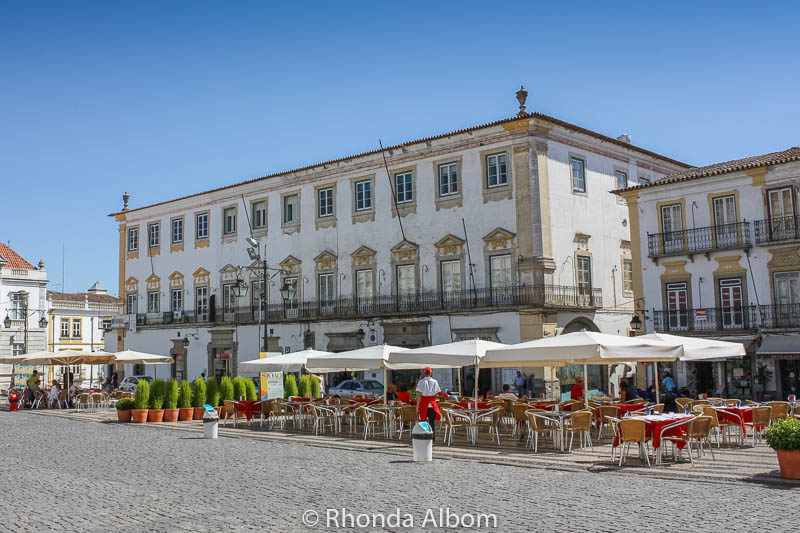 Outdoor restaurants on Giraldo Square in the main square in Evora Portugal