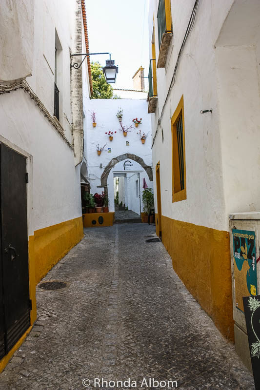 One of many alleyways leading from Giraldo Square in Evora Portugal