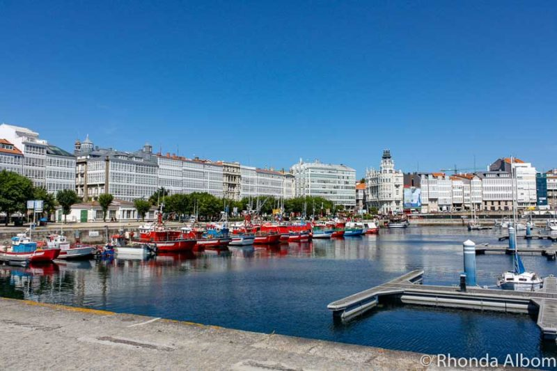 Marina in La Coruna Spain with the enclosed balcony buildings in the background