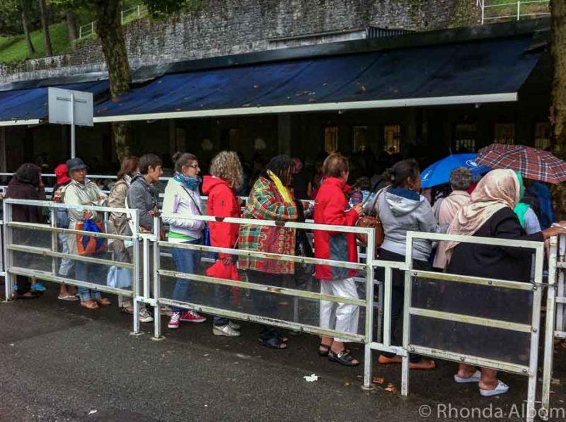 The women's queue to enter the grotto and dip into the Lourdes healing water France