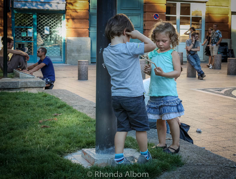 Two adorable kids in a square in Toulouse France