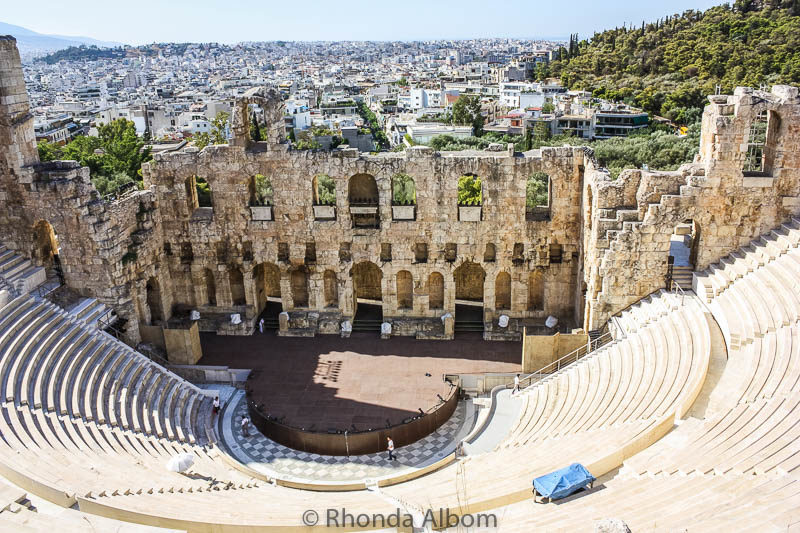 The Odeon of Herodes Atticus is a stone theatre on the Acropolis in Athens Greece