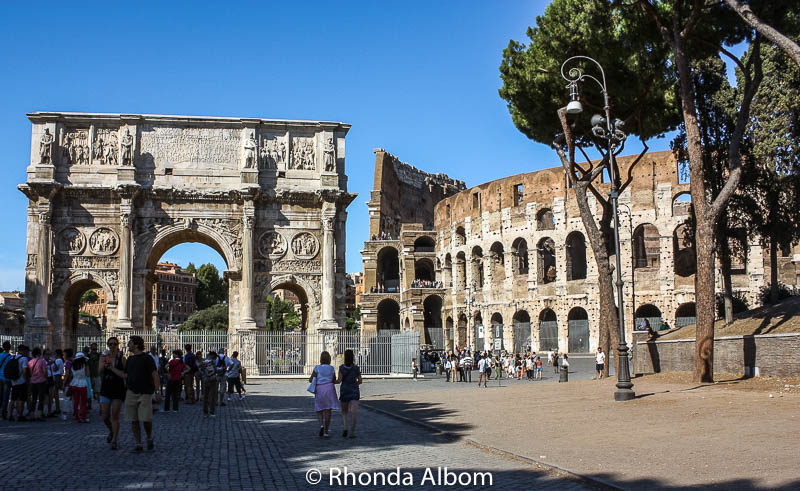 Arch of Constantine stands next to the Colosseum in Rome, Italy