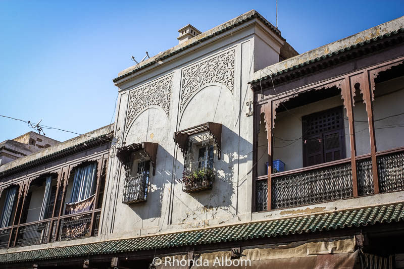 Houses in the old Jewish quarter in Fes, Morocco have balconies and large windows