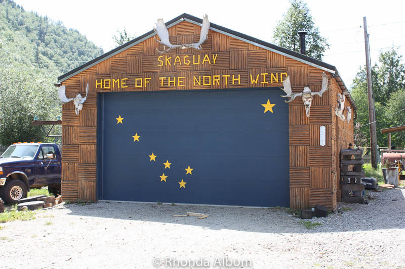 The stars of the Alaska flags on a garage door.