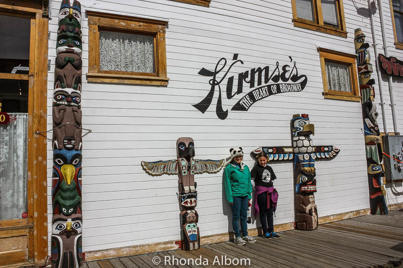 Totem poles outside a shop on Broadway in Skagway Alaska