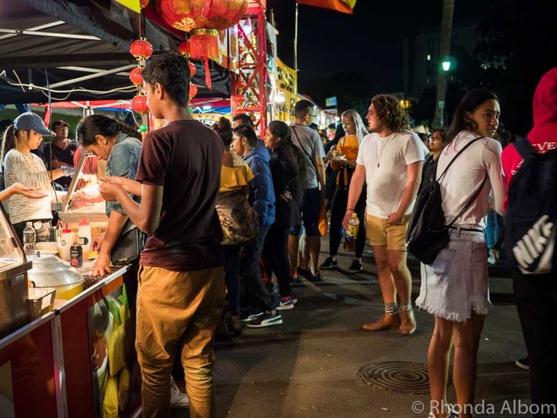 Crowds and food stalls at the Auckland Lantern Festival