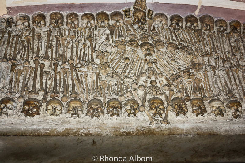 Wall decor at the Chapel of Bones in Evora, Portugal