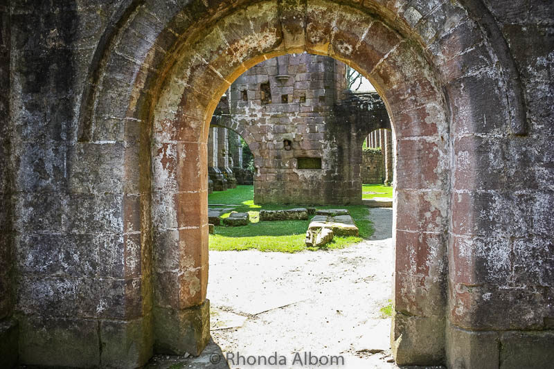 Archway of Fountains Abbey in Yorkshire, England UK