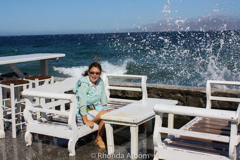 Water splashing over a seawall on a Greek island