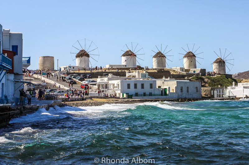 Mykonos windmill with hoards of tourists heading towards them from the Mykonos cruise port