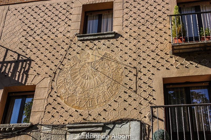 A sun dial molded onto a wall in Segovia Spain