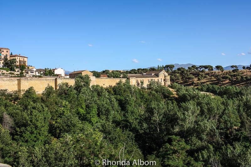 View of the city wall surrounding Segovia Spain