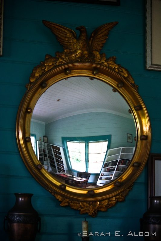 Reflection from a mirror of Robert Stevenson's Library in the Robert Louis Stevenson Museum in Samoa. Photo copyright ©Sarah Albom 2014