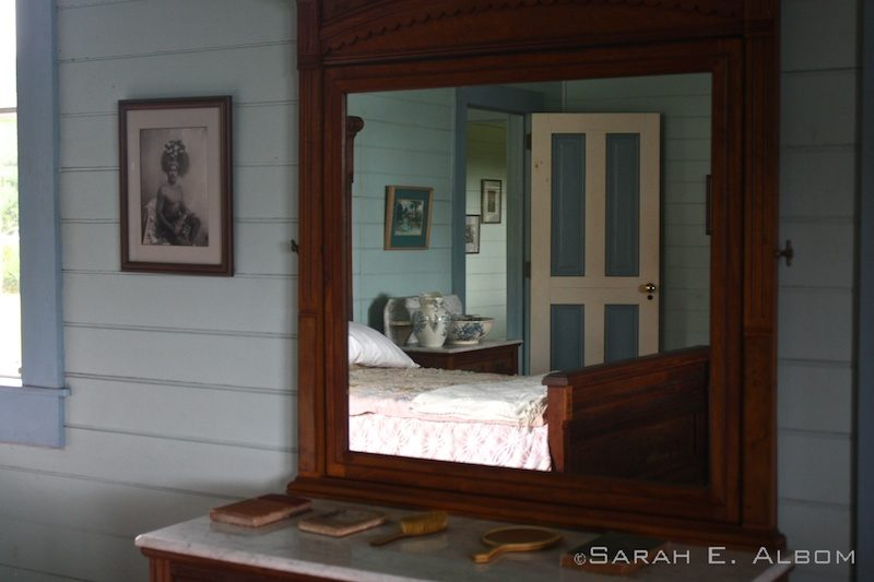 Reflection of bedroom in mirror in the Robert Louis Stevenson Museum in Samoa. Photo copyright ©Sarah Albom 2014