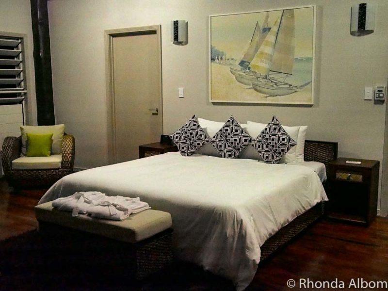 King bed in a villa at Saletoga Sands resort in Samoa