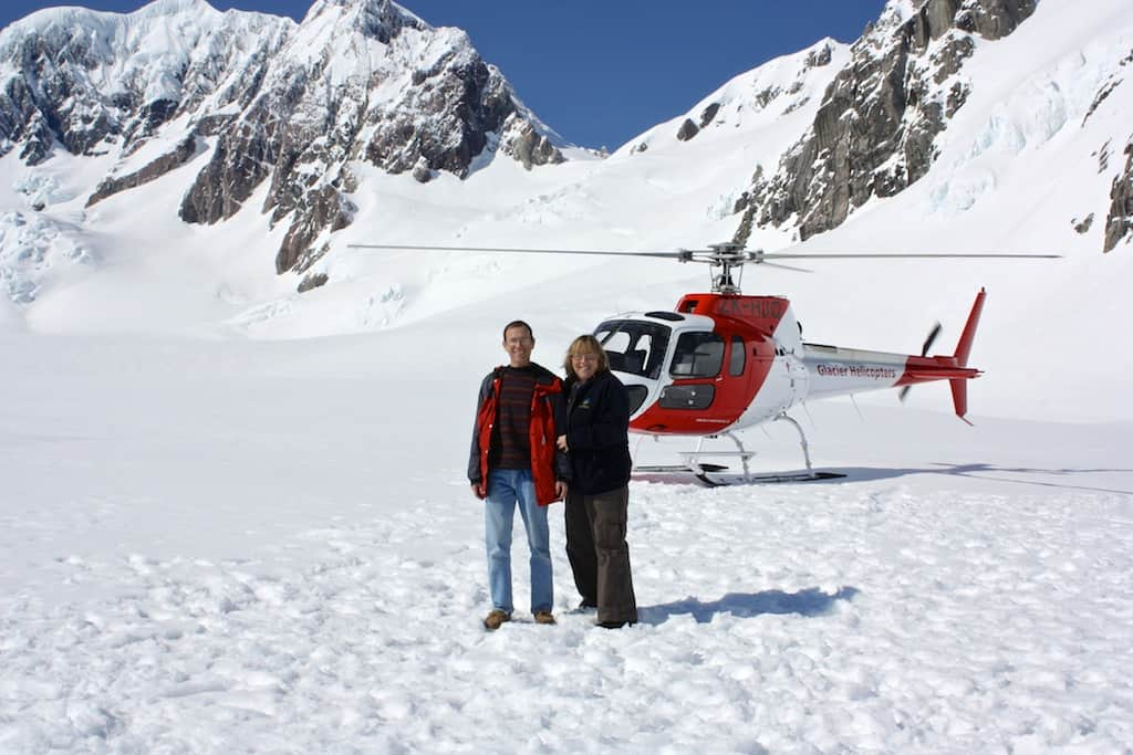 Standing on Fox Glacier in front of the hellcopter that brought us here.
