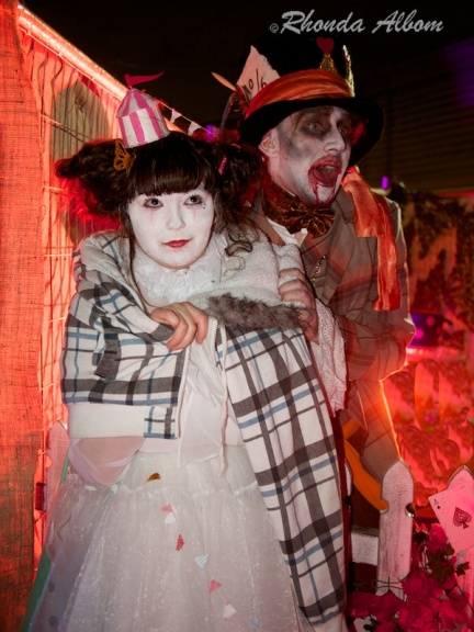 The Mad Hatter and a clown at MOTAT on Halloween in New Zealand