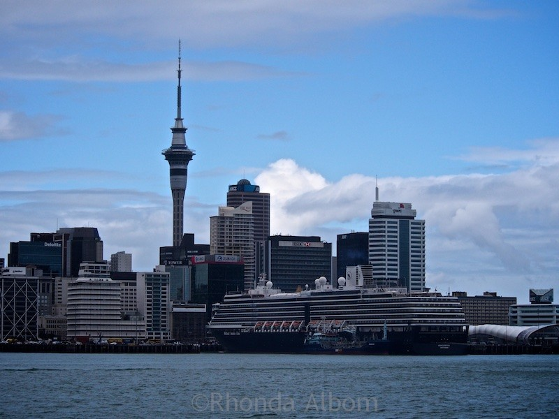 Auckland skyline seen from the ferry into the city. The HAL Oosterdam is in port.