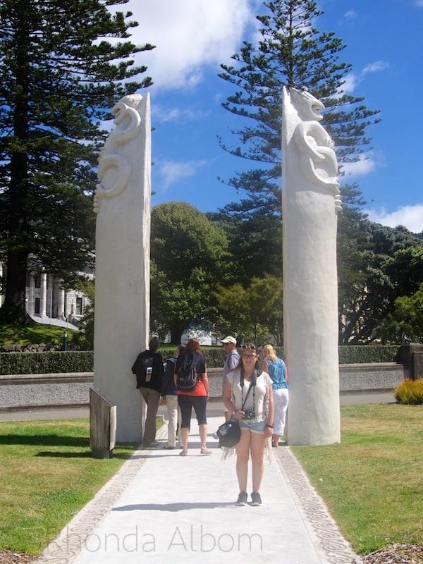 The pole like Maori statues are called Po and represent the upturned Waka (Maori canoe). The tour group is Walk Wellinton.