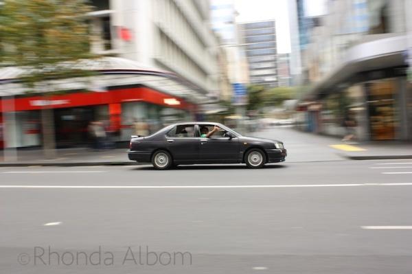 Traffic on Queen Street in Auckland New Zealand