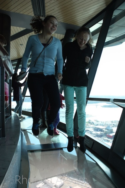 Jumping on the glass floor in the observation deck of the Auckland Sky Tower