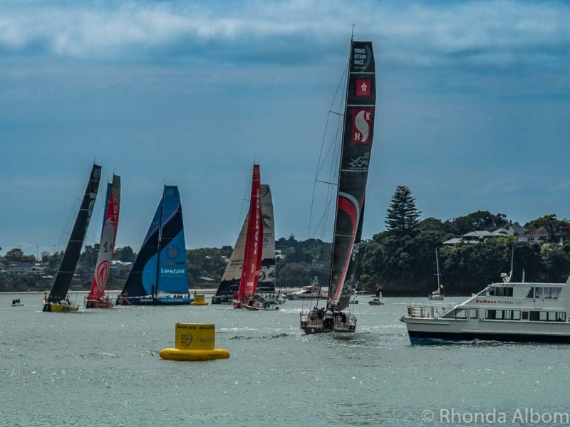 A ferry crossing near the Volvo Ocean Race yachts, Auckland New Zealand
