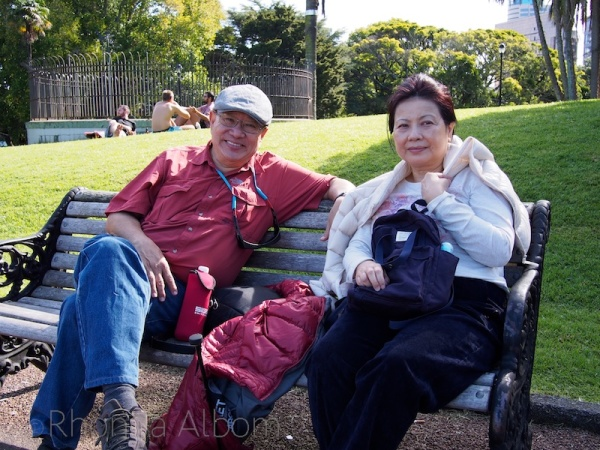 Couple on a bench in Albert Park, Auckland New Zealand