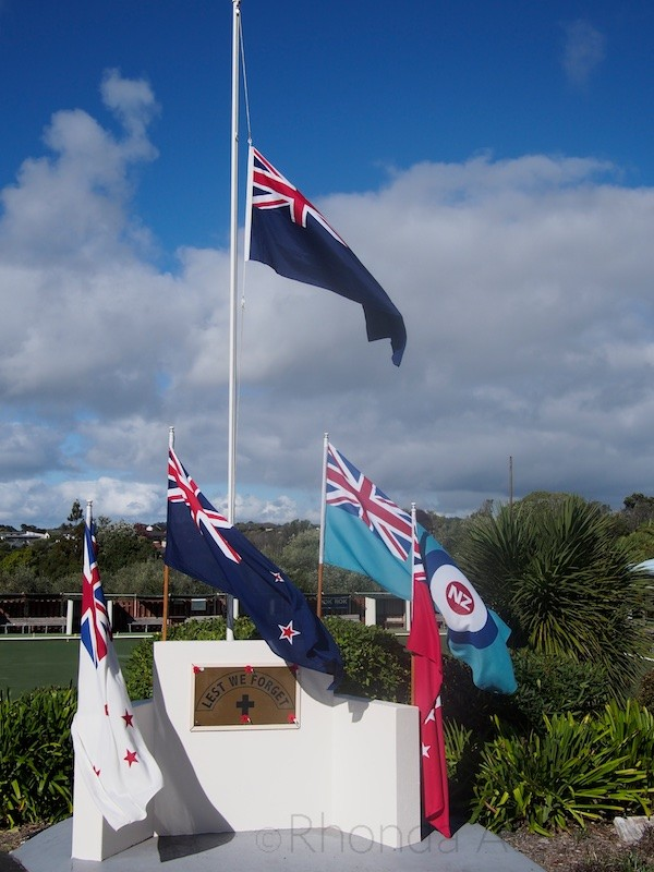 Flags hang at half mast at war memorial at the Silverdale RSA, Auckland New Zealand