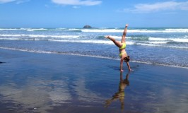 Cartwheel on the beach in Auckland, New Zealand