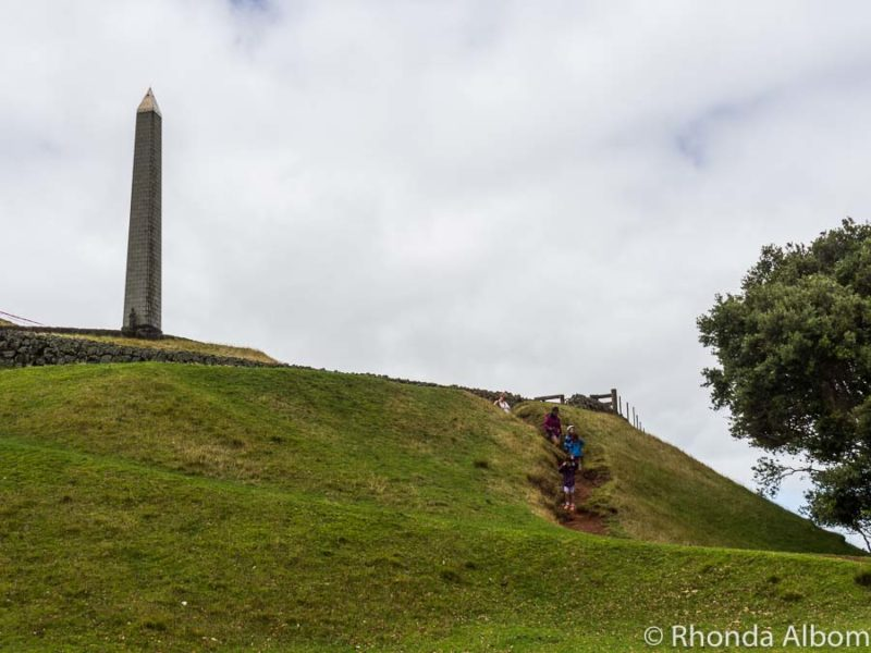 Locals hike to the monument on One Tree Hill in Cornwall Park in Auckland New Zealand