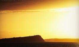 Sunrise silhouette over the cliff tops, Auckland, New Zealand - Photograph copyright Sarah E. Albom 2015