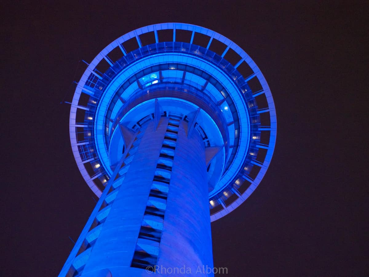 Auckland Sky Tower lit up at night looks a bit like an alien ship flying over Auckland New Zealand