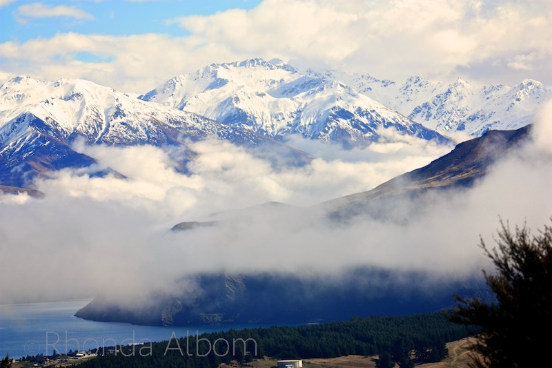 View of the Southern Alps from the top of Mount Iron in Wanaka New Zealand