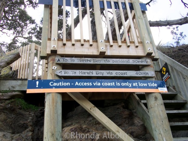 Warning sign about hiking from Pink Beach in Shakespear Park Auckland New Zealand