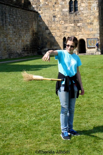 Raising the broomstic like Harry Potter by saying UP at Alnwick Castle in England