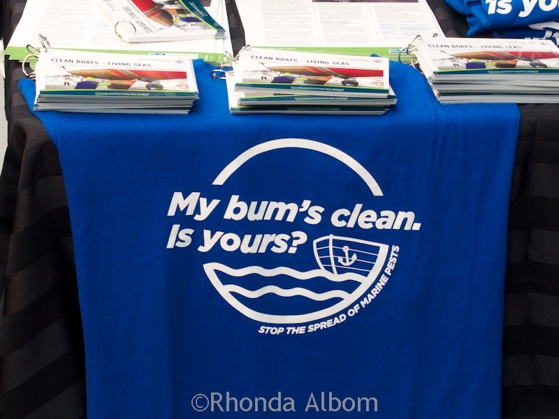Funny T-Shirt reminding people to clean boat bottoms to stop the spread of marine pest. Seen at the Auckland Boat Show 2015 - New Zealand