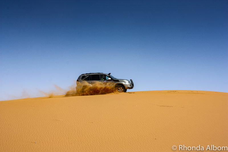 Driving across the sand dunes in the Moroccan Sahara