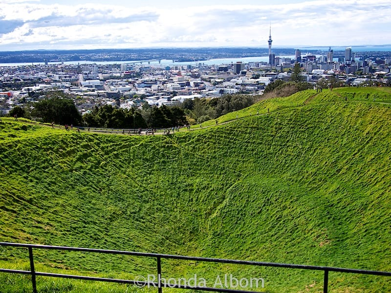 The Auckland city skyline seen while looking over the 50 metre crater of the extinct Mount Eden Volcano, Auckland New Zealand.