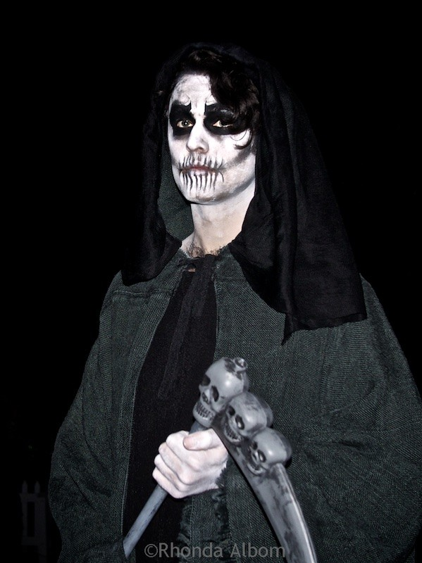 The Grim Reaper calls forth the dead from their graves to dance at the Danse Macabre, The Olde Hallows Eve festival at MOTAT in Auckland New Zealand