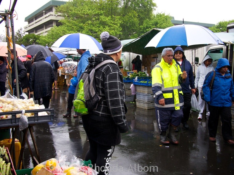 Shoppers at the Otara Market on a rainy Saturday in Auckland New Zealand