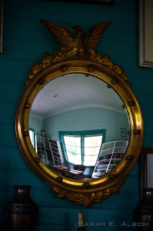 Mirror reflecting the library of the Robert Louis Stevenson house/museum in Samoa. Photo copyright Sarah E. Albom ©2014